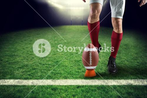 Composite image of low section of sports player kicking ball