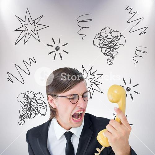 Composite image of geeky businessman shouting at retro phone