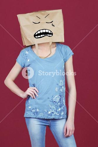 Composite image of woman posing with bag on head