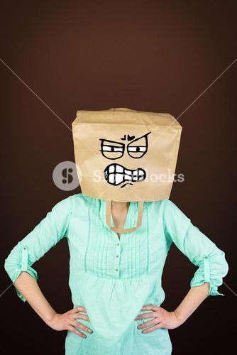 Composite image of woman covering head with brown paper bag