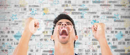 Composite image of football player screaming while clenching fists