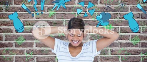 Composite image of angry woman covering ears