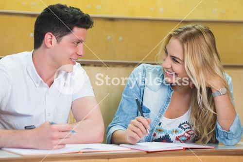College students smiling at each other