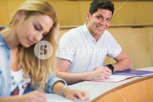 Male students smiling at camera