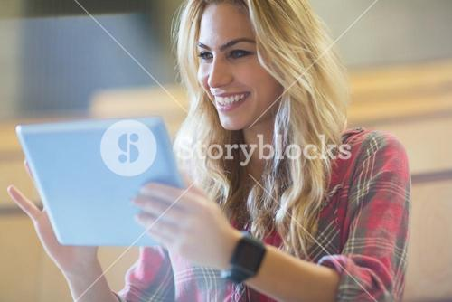 Smiling female student using tablet