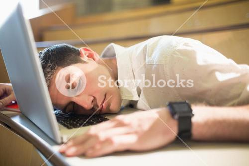 Male student falling asleep during class