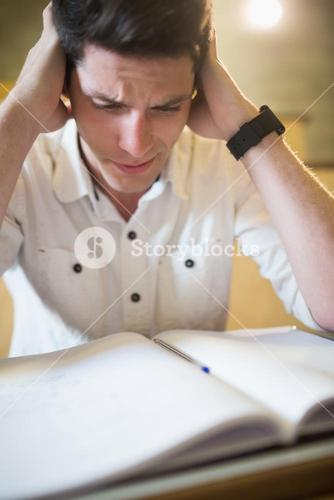 Anxious male student during exam