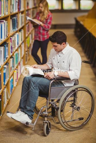 Student in wheelchair talking with classmate