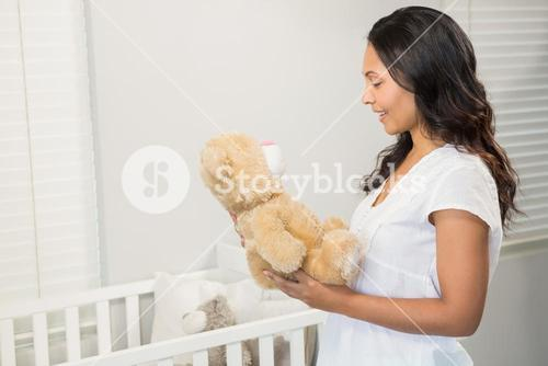 Smiling brunette holding plush