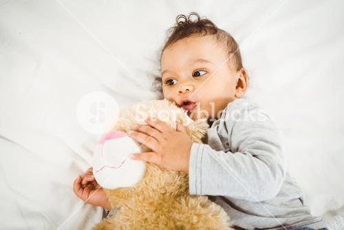 Cute baby holding plush