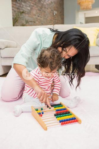 Mother and baby playing with abacus