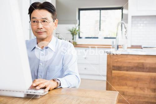 Concentrated man using computer
