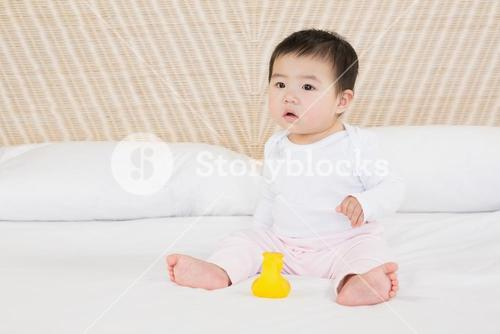 Cute baby on bed