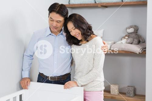Happy couple looking in crib