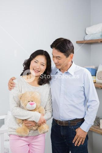 Smiling couple with teddy bear