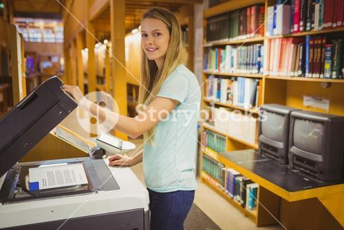 Smiling blonde student making a copy