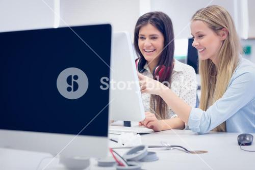 Smiling students using computer