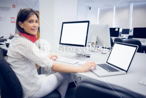 Smiling student working on computer