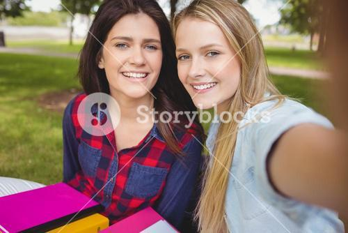 Smiling students studying outdoor