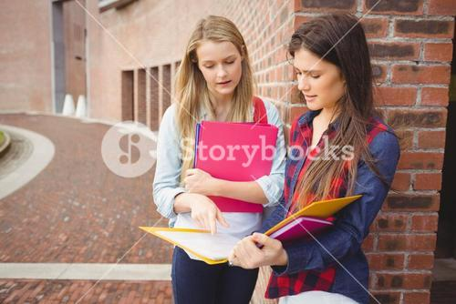 Serious students reading book