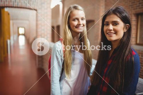 Smiling students in the hallway