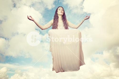 Composite image of portrait of woman levitating with eyes closed