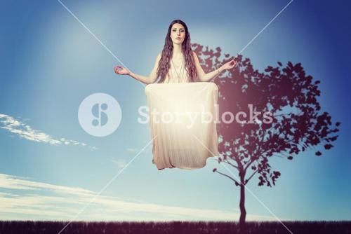 Composite image of portrait of beautiful woman levitating