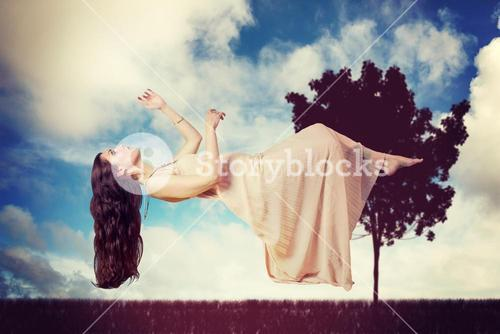 Composite image of full length of beautiful woman flying