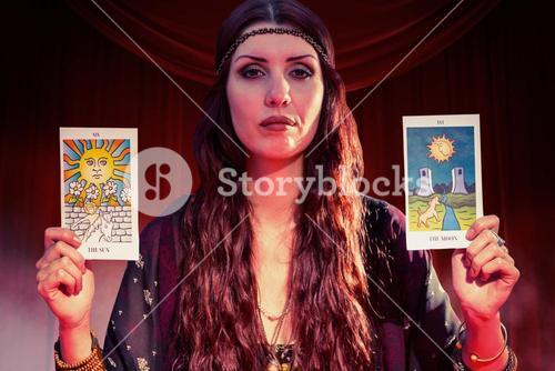 Composite image of portrait of fortune teller woman showing tarot cards
