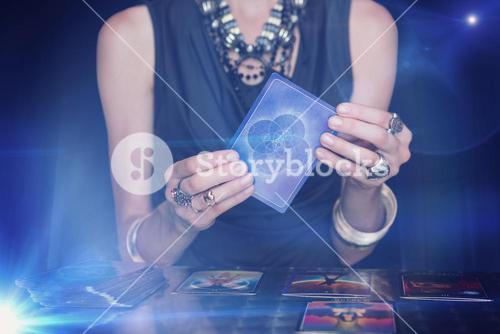 Composite image of fortune teller forecasting the future with tarot cards