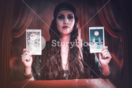 Composite image of portrait of serious fortune teller woman