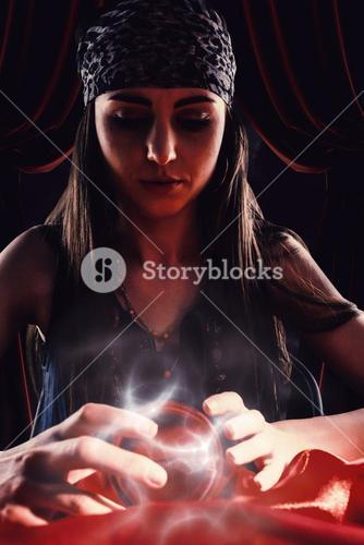 Composite image of fortune teller using crystal ball