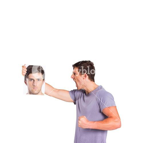 Man shouting at picture of himself