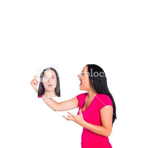 Woman shouting at picture of herself