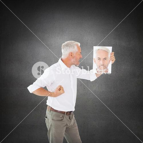 Composite image of man shouting at himself