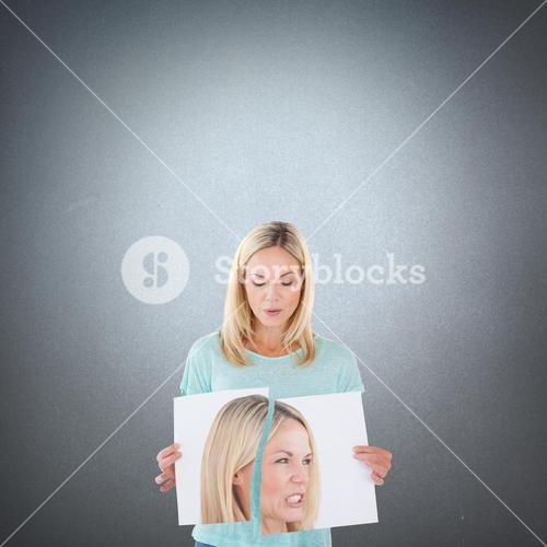 Composite image of woman ripping picture of herself