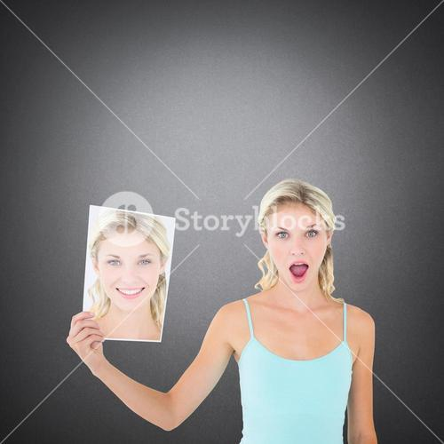 Composite image of woman showing picture of herself