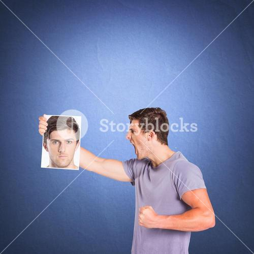 Composite image of man shouting at picture of himself