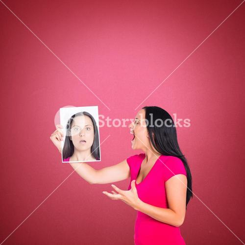 Composite image of woman shouting at picture of herself