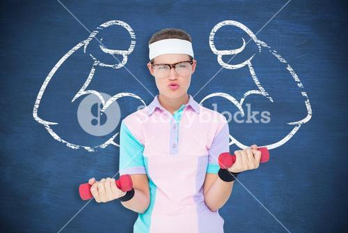 Composite image of geeky hipster girl lifting dumbbells