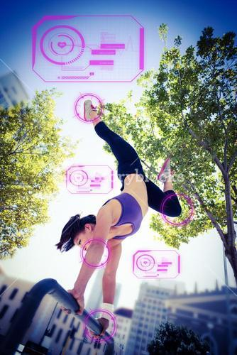 Composite image of athletic woman performing handstand on bar