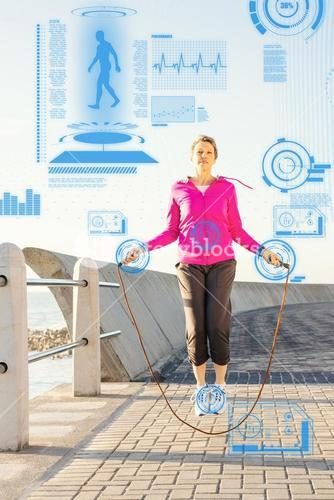 Composite image of sporty woman skipping at promenade