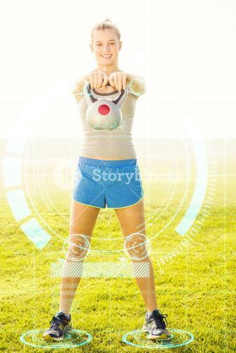 Composite image of smiling sporty blonde exercising with kettlebell