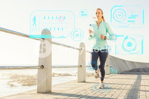 Composite image of focused fit blonde jogging at promenade