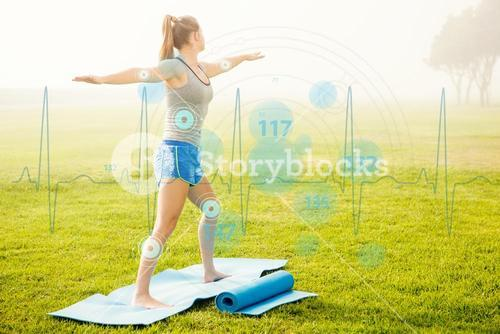 Composite image of sporty blonde doing yoga on exercise mat