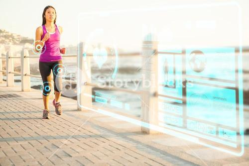 Composite image of fit woman jogging at promenade
