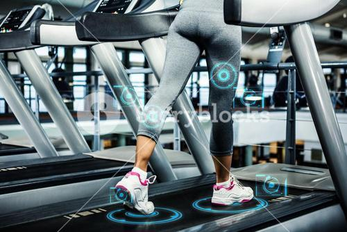 Composite image of woman running on treadmill