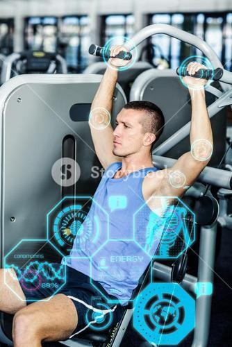 Composite image of serious man using exercise machine