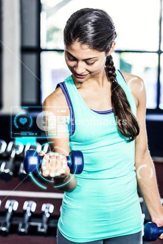 Composite image of fit woman exercising with dumbbells