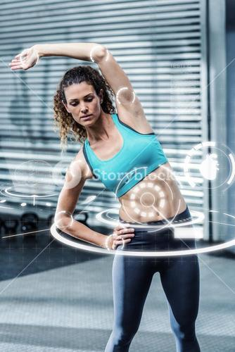 Composite image of muscular woman stretching her body